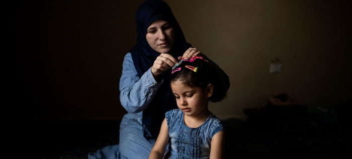 Refugee Resettlement - Mother Grooming Daughter
