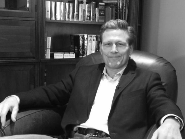 David Baldacci seated in his study
