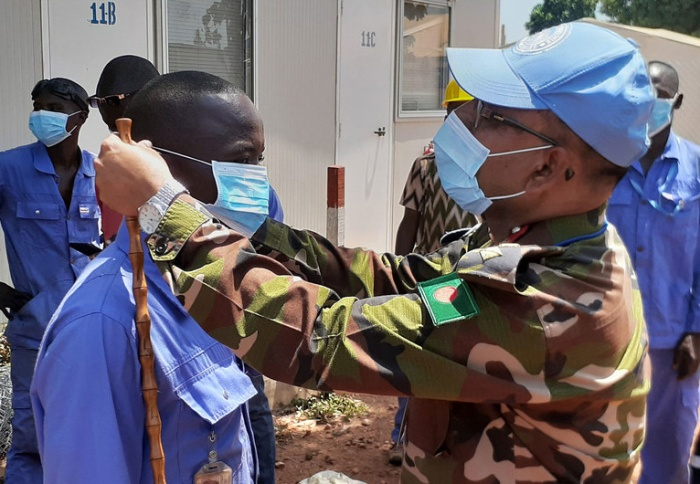 Protection Crisis - Peacekeeper Puts Mask on Student