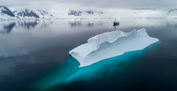 Antarctic Conservation - Iceberg and Ship in Southern Ocean