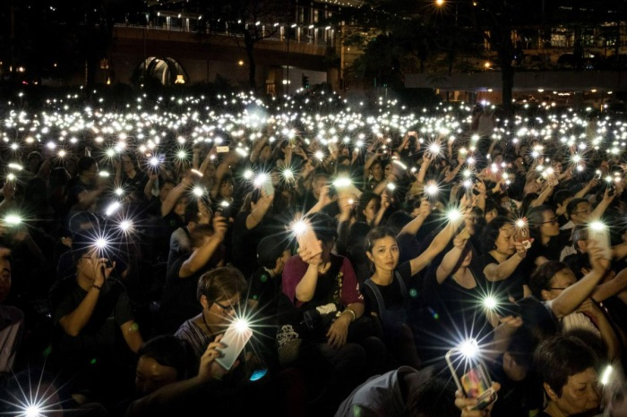 China's Human Rights - Protestors Hold Up Phones with Lights On